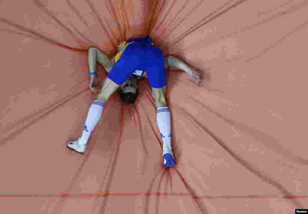 Alexandru Tufa of Romania competes during the men's high jump qualification event at the European Athletics Indoor Championships in Sweden on March 1. (Reuters/Pawel Kopczynski)