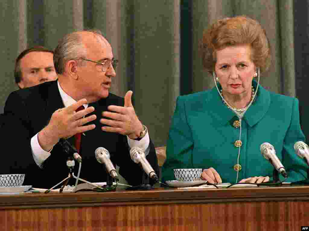 Soviet President Mikhail Gorbachev talks to Bristish Prime Minister Margaret Thatcher during their joint press conference in Moscow in June 1990.