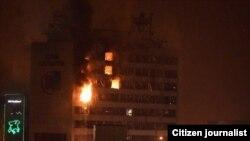 Пожар в Доме печати в Грозном после спецоперации полиции против боевиков. 4 декабря 2014 года.