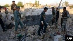 Жалал-Абад шаарындагы полициякананын бир бөлүгү жанкечтинин бомба чабуулунун кийин. 1-июнь, 2015-жыл