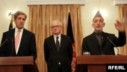 "Afghan President Hamid Karzai (right) and U.S. Senator John Kerry in Kabul, with the UN's Kai Eide -- Kerry praised Karzai's ""dedication to building a lasting democracy."""