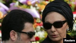 Alireza Pahlavi with his mother at the funeral for the prince of Monaco in Monte Carlo in 2005