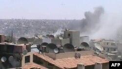 Відеокадр: обстріл, як стверджується, урядовими військами одного з районів міста Хомс у центрі Сирії, викладено на YouTube 19 червня 2012 року, автентичність не перевірена