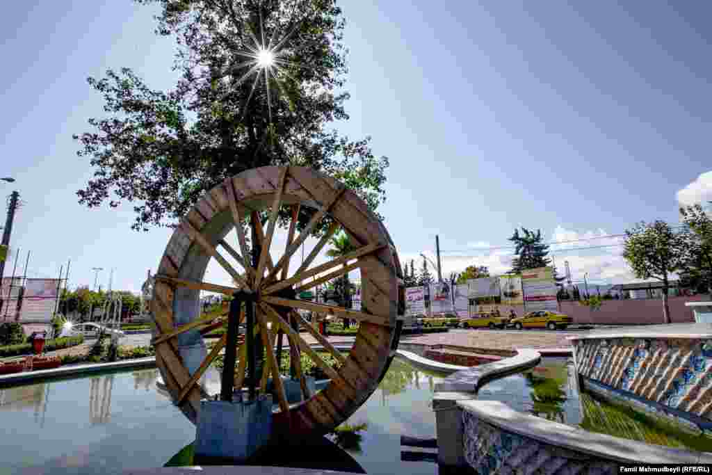 A watermill, once used to grind flour, now stands as a piece of public art in the city.