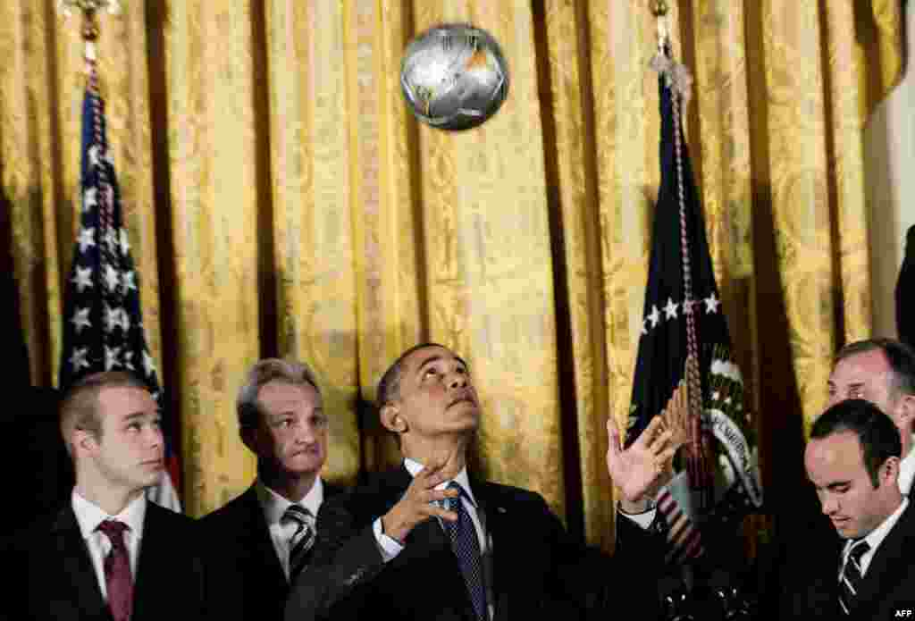 U.S. President Barack Obama bounces a soccer ball off his head during an event at the White House in Washington. Obama hosted an event to honor the 2012 MLS Cup champions, the Los Angeles Galaxy, and the 2012 Stanley Cup champions, the Los Angeles Kings. (AFP/Brendan Smialowski)