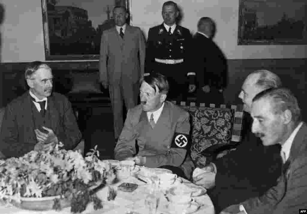 "Neville Chamberlain and Adolf Hitler meet for the ""talk over the teacups"" at Berchtesgaden, Germany, on September 24, 1938. Hitler demanded that Czechoslovakia cede the Sudetenland by September 28. Following a political crisis in May, Hitler had told his generals that an invasion should begin no later than October 1."