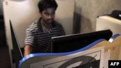 A computer user at an Internet cafe in Karachi, Pakistan on May 19.
