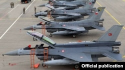 Azerbaijani - Turkish F-16 fighter jets parked at an Azerbaijani military airfield, 20Sep2014.