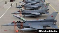 Azerbaijani - Turkish F-16 fighter jets parked at an Azerbaijani military airfield, 20Sep2014.