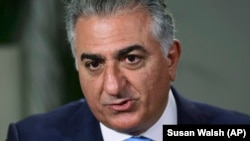 U.S. -- Reza Pahlavi, the exiled son of Iran's last shah before the 1979 Islamic Revolution and a critic of the country's clerical leaders, speaks during an interview with The Associated Press in Washington, Tuesday, Jan. 9, 2018