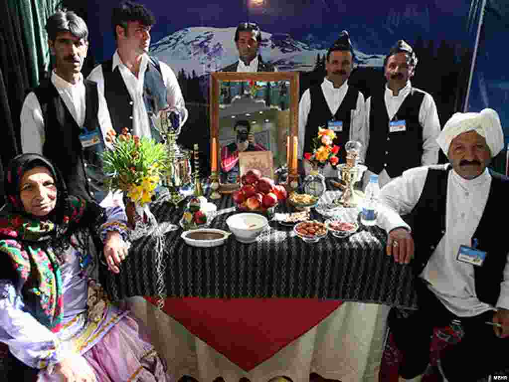 "A family gathers around a ""haft sin"" table, prepared with symbolic items - Noruz08"