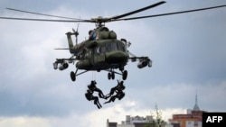 Belarusian paratroopers demonstrate their skills during exercises in the town of Brest in June.
