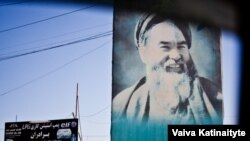 A poster of former warlord Abdul Ali Mazari hangs along a street in Mazar-e Sharif in June 2015.