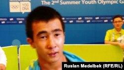 17 жастағы балуан (еркін күрестен) Мұхамбет Қуатбек. Нанкин, 27 тамыз 2014 жыл.