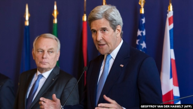 U.S. Secretary of State John Kerry speaks as French Foreign Minister Jean-Marc Ayrault looks on following talks in Paris.