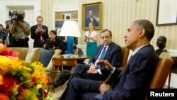 Грчкиот премиер Андонис Самарас со американскиот претседател Барак Обама.