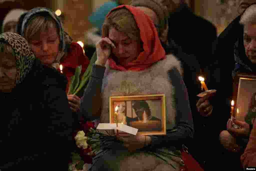 Relatives of victims of the April 3 subway bombing in St. Petersburg attend a memorial service at Trinity Cathedral in the city. (Reuters/Anton Vaganov)