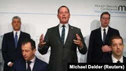 U.S. Ambassador to Germany Richard Grenell (center) speaks as Kosovar President Hashim Thaci (left) and Serbian President Aleksandar Vucic look on at the Munich Security Conference in Munich on February 14.