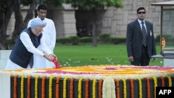 Indian Prime Minister Manmohan Singh places a floral tribute at the Samadhi of Mahatma Gandhi at Rajghat during celebrations of the country's 67th Independence Day in New Delhi on August 15.
