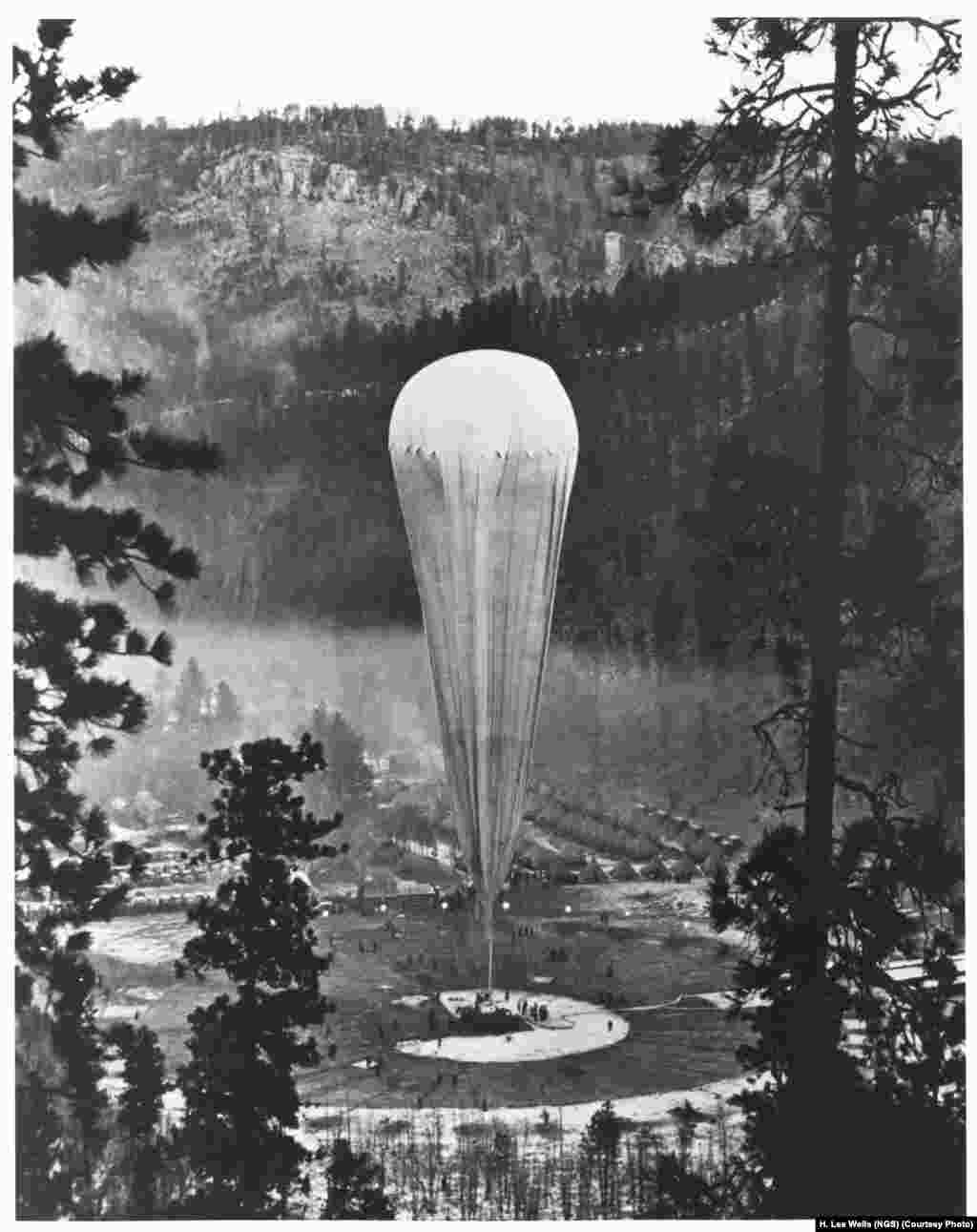 "The National Geographic-Army Air Corps stratosphere balloon ""Explorer II"" prepares to rise from the Stratobowl near Rapid City, South Dakota on November 11, 1935. It carried two ""aeronauts"" more than 22,000 meters into the stratosphere -- the highest humans would go for the next 21 years."