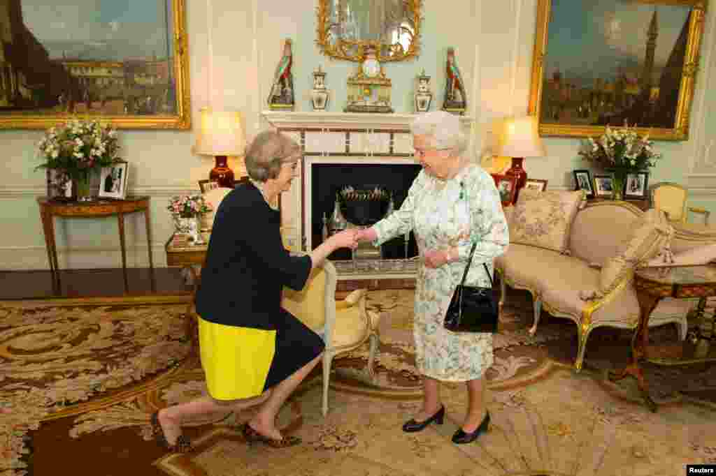 Britain's Queen Elizabeth welcomes Theresa May at the start of an audience in Buckingham Palace, where the monarch formally invited her to become Prime Minister, in London on July 13. (Reuters/Dominic Lipinski)