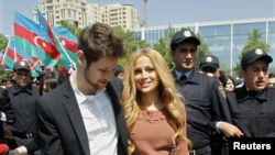 Eurovision Song Contest winners Eldar Gasimov (left) and Nigar Jamal meet the crowds in Baku after their win