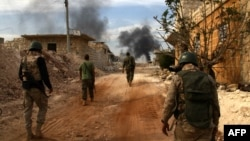 Syrian government forces patrol the outskirts of embattled Syrian city of Aleppo earlier this week.