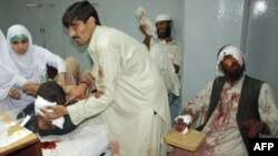 Doctors in Peshawar treat some of the dozens of Pakistanis injured in a suicide blast.