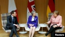 Президент Франции, премьер-министр Великобритании и канцлер Германии на саммите в Брюсселе.