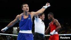 Казахстанский боксер Адильбек Ниязымбетов после победы над Джошуа Буатси в полуфинале на Играх в Рио, 16 августа 2016 года.