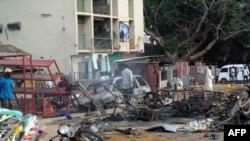 Сцена теракта на севере Нигерии 23 июля 2014 года.