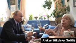 Russian President Vladimir Putin congratulates head of the Moscow Helsinki Group Lyudmila Alekseyeva on her 90th birthday.
