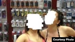"The MTS mobile-phone retailer says provocative staff photos that ended up on social media were taken as part of an ""informal team-building exercise."""