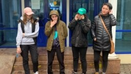 Asya Tulesova (far right) and other young activists have helped spark a resurgence in opposition politics in Kazakhstan.