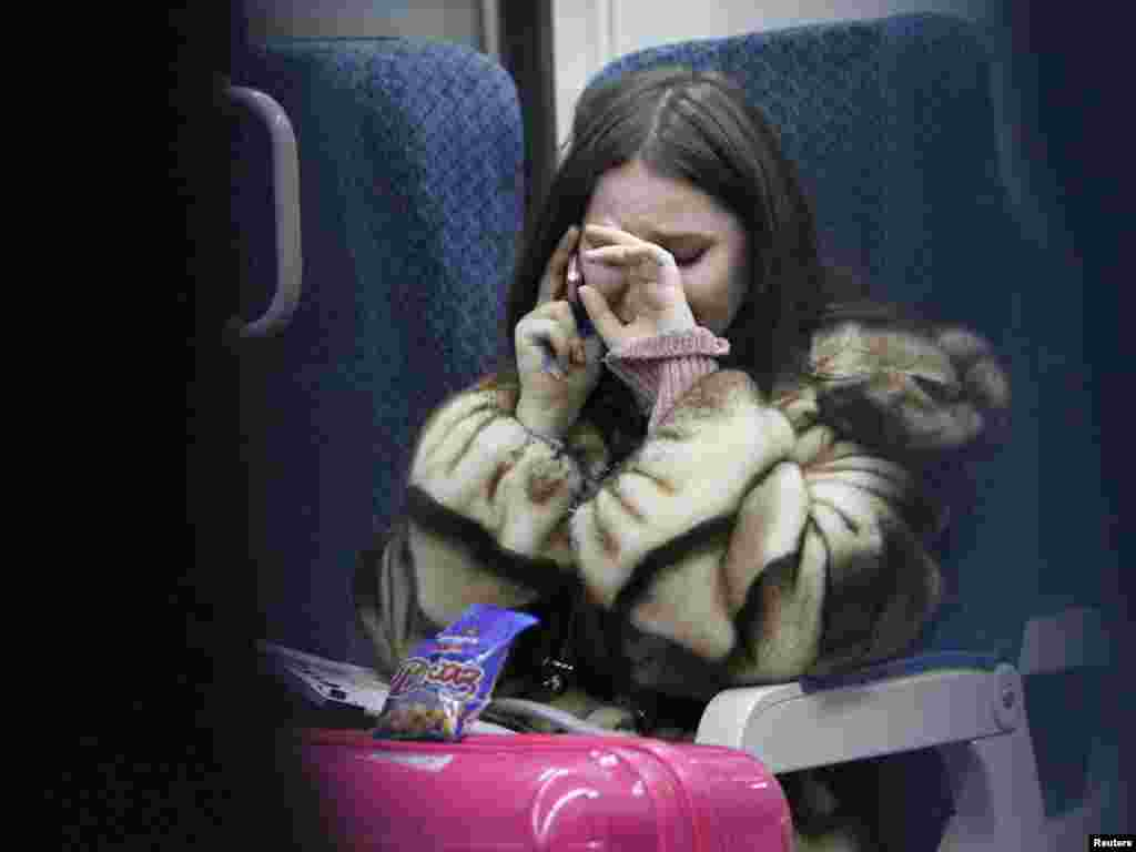 A woman cries while talking on the phone to an acquaintance at Moscow's Domodedovo Airport as news broke of a suicide bombing there that killed 31 people and injured more than 130 on January 24. (Reuters/Denis Sinyakov)