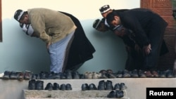 Muslim men pray at a mosque in the Tajik village of Nurabad on the holy day of Eid al-Adha.