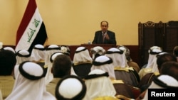Iraqi Prime Minister Nuri al-Maliki speaks during a meeting with tribal leaders in Mosul in late May.