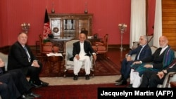 U.S. Secretary of State Mike Pompeo, left, met with Afghan President Ashraf Ghani, Afghan Chief Executive Officer Abdullah Abdullah, and former Afghan President Hamid Karzai, right, at the Presidential Palace in Kabul, on June 25.