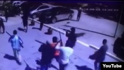A screen grab of a YouTube video showing masked gunmen on the streets of Aqtobe after the attacks.