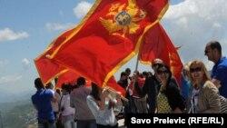 Торжества в Черногории по случаю шестой годовщины референдума, в ходе которого черногорцы высказались за выход страны из союза с Сербией. Ловчен, 21 мая 2014 года.