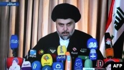 صورة مأخوذة من التلفزيون لخطاب الصدر