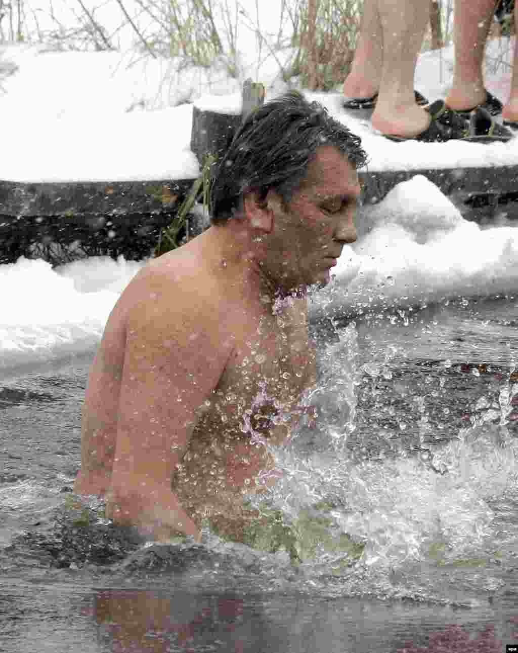 Ukrainian President Viktor Yushchenko takes a dip in the ice-cold waters of the Dnieper River in January (epa) - Oil and gas are forms of 'soft power,' but it felt hard and harsh to Ukrainians when, in the middle of winter, Russia turned the gas taps off. Georgians too found themselves freezing, and few there believed the January explosions that cut the pipeline from Russia were accidental. The suspicions persisted and across Europe politicians voiced fears that Russia is using its energy power too energetically.