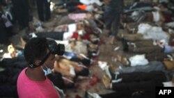 Oturma lagerlerine geçirilen reýdden soň... Kair, 14-nji awgust, 2013.