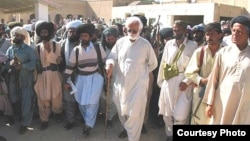 Nawab Akbar Khan Bugti surrounded by supporters and guards.