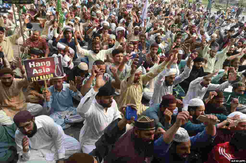 Supporters of Tehrik-e-Labaik Pakistan (TLP), a hard-line religious political party, chant slogans during a protest against a Supreme Court decision to overturn the conviction of a Christian woman, Asia Bibi, in Lahore on October 31. Bibi is a Christian mother who was facing execution for blasphemy against Islam. (AFP/Arif Ali)