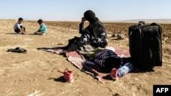 Сириядагы качкын аял балдары менен