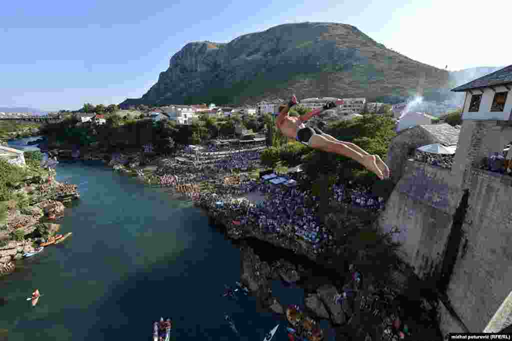 A diver takes the plunge into the Neretva River from the 21-meter Old Bridge in the Bosnian city of Mostar. It was the 450th edition of the unique diving competition.