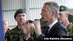 NATO Secretary-General Jens Stoltenberg speaks to Estonian soldiers at the Tapa military base on September 6.