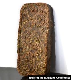 A brick of low-grade Georgian tea pressed with Soviet machinery.