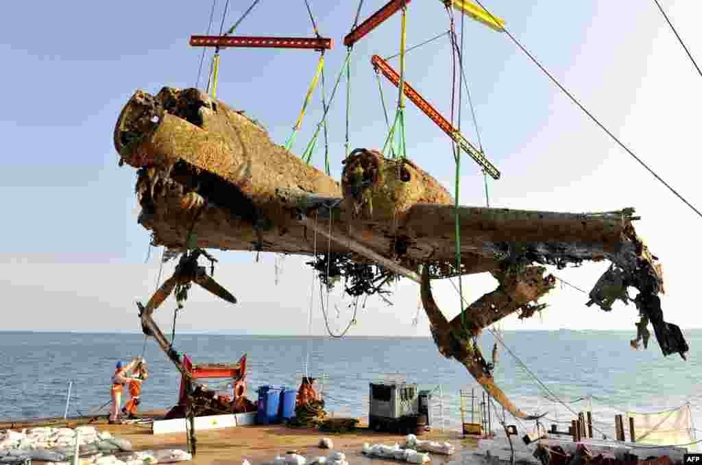 The wreck of a German World War II Dornier Do-17 is raised to the surface of a ship at Goodwin Sands, Kent, at the mouth of the English Channel. The aircraft was shot down during the Battle of Britain in 1940. The operation to retrieve it was the biggest of its kind in British waters, the museum said. (AFP)
